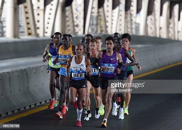 Men's elite runners cross the 59th Street bridge in the 2015 TCS New York City Marathon November 1 2015 in New York Kenyan Stanley Biwott won the New...