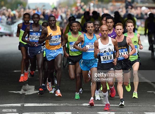 Men's elite runners run up First Aveue in the 2015 TCS New York City Marathon November 1 2015 in New York Kenyan Stanley Biwott won the New York...