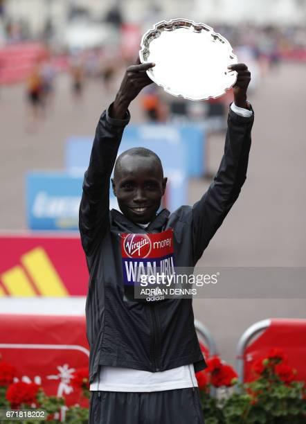 Men's elite winner Kenya's Daniel Wanjiru poses after winning the men's elite race at the London marathon on April 23 2017 in London / AFP PHOTO /...