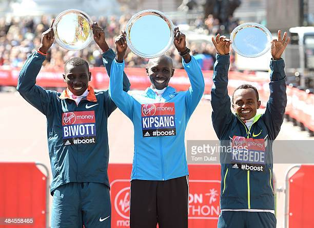 Men's Elite winner Wilson Kipsang of Kenya poses with second placed Stanley Biwott of Kenya and third placed Tsegaye Kebede of Ethiopia following the...