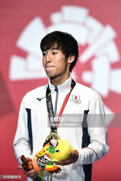 Men's Epee Individual bronze medalist Kano Koki of Japan celebrates on the podium during the victory ceremony on day one of the Asian Games on August...