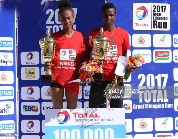 Men's first place winner Ethiopian Solomon Berega and women's first place winner Zeyneba Yemer in the Great Ethiopian Run pose during awards ceremony...
