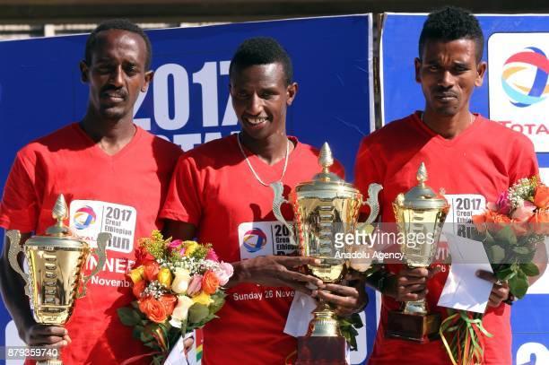 Men's first place winner Ethiopian Solomon Berega second place winner Moges Ekubaey and third place winner Dawit Fekadu in the Great Ethiopian Run...