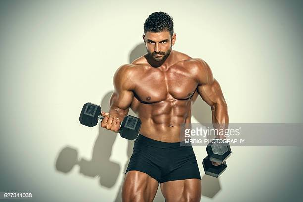 men`s fitness - handsome bodybuilders stock photos and pictures