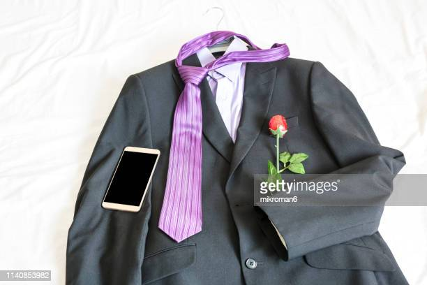 men's formal-wear and smartphone on bed - striped blazer stock pictures, royalty-free photos & images
