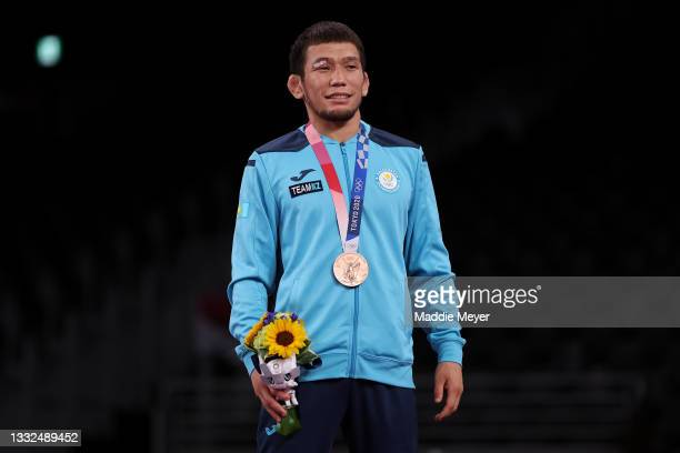 Men's Freestyle 57kg bronze medalist Nurislam Sanayev of Team Kazakhstan poses with his medal during the Victory Ceremony on day thirteen of the...