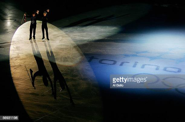 Mens Gold Medalist Evgeni Plushenko of Russia and violinist Edvin Marton acknowledge the crowd after performing during the gala exhibition of the...