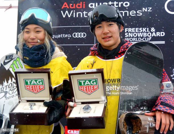 Men's gold medalist Yuto Totsuka of Japan and Women's gold medalist Chloe Kim of the United States pose on the podium after the Winter Games NZ FIS...