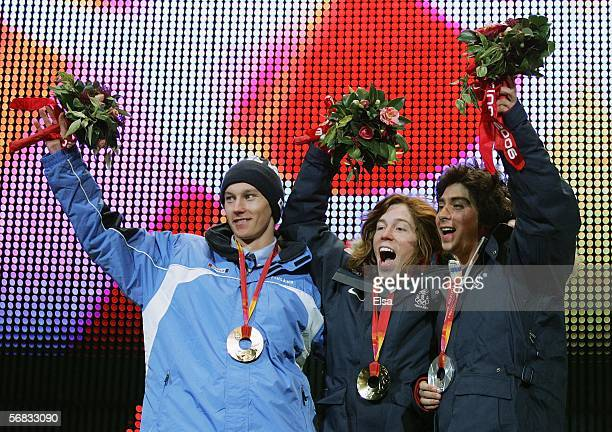Men's Halfpipe Medal winners Daniel Kass and Shaun White of the United States and Markku Koski of Finland acknowledge the crowd during the Medal...