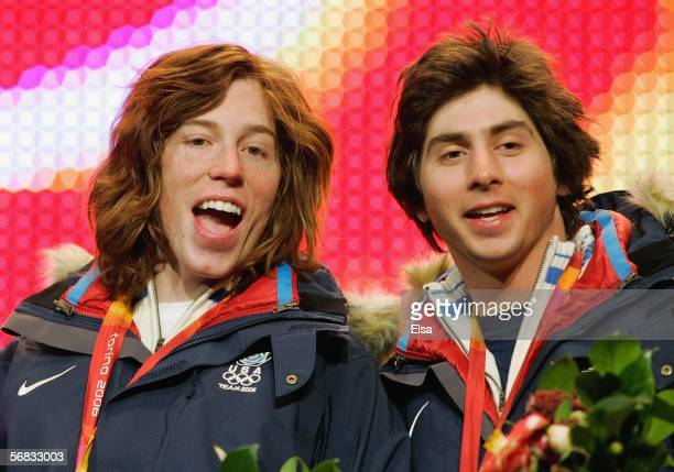 Men's Halfpipe medalists Shaun White and Daniel Kass of the United States acknowledge the crowd during the Medal Ceremony on Day 2 of the Turin 2006...