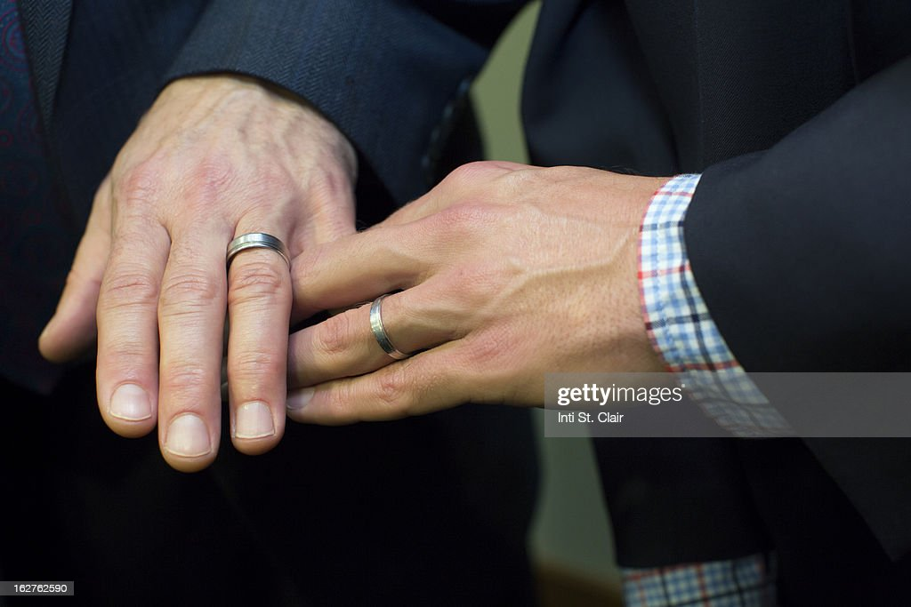 mens hands together showing wedding rings stock photo - Wedding Rings On Hands
