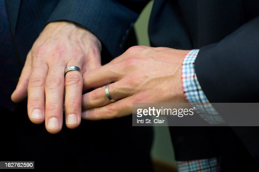 Mens Hands Together Showing Wedding Rings Stock Photo