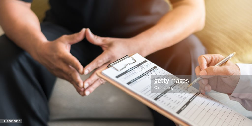 Men's health exam with doctor or psychiatrist working with patient having consultation on diagnostic examination on male disease or mental illness in medical clinic or hospital mental health service : Stock Photo