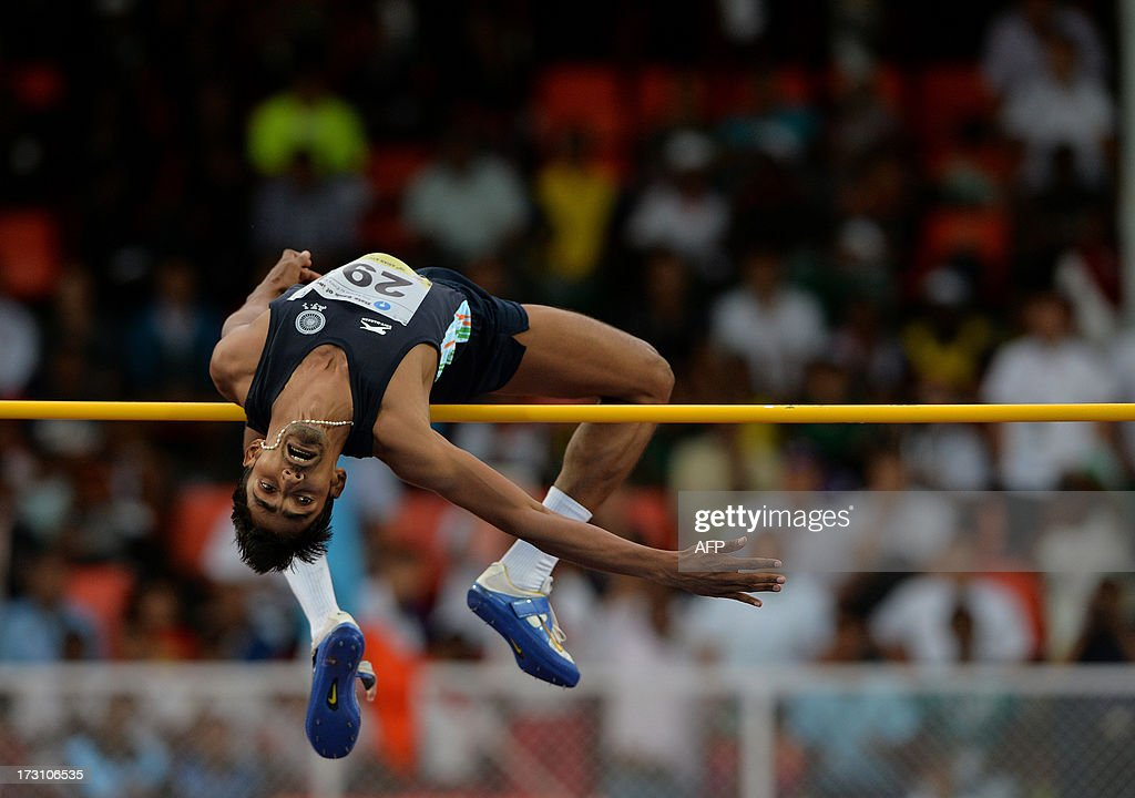 Men's high jump joint silver medal winner from India Jithin C. Thomas in action on the fifth and the final day of Asian Athletics Championship 2013 at the Chatrapati Shivaji Stadium in Pune on July 7, 2013. The silver medal was shared between Indian athlete Jithin C. Thomas and Iranian athlete Keyvan Ghanbarzadeh. AFP PHOTO/Manjunath KIRAN
