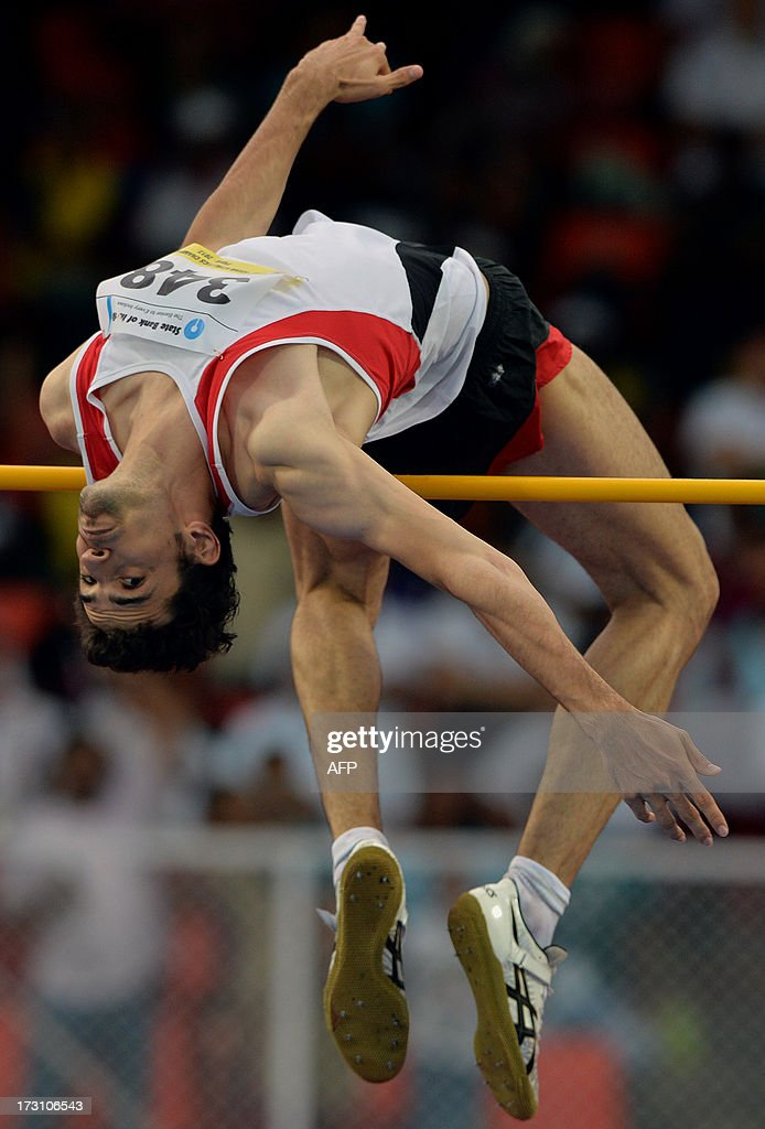 Men's high jump joint silver medal winner from Iran Keyvan Ghanbarzadeh in action on the fifth and the final day of Asian Athletics Championship 2013 at the Chatrapati Shivaji Stadium in Pune on July 7, 2013. The silver medal was shared between Indian athlete Jithin C. Thomas and Iranian athlete Keyvan Ghanbarzadeh. AFP PHOTO/Manjunath KIRAN