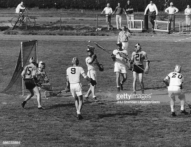 Men's lacrosse match between Johns Hopkins University and the United States Military Academy at West Point as the referee blows his whistle to end a...