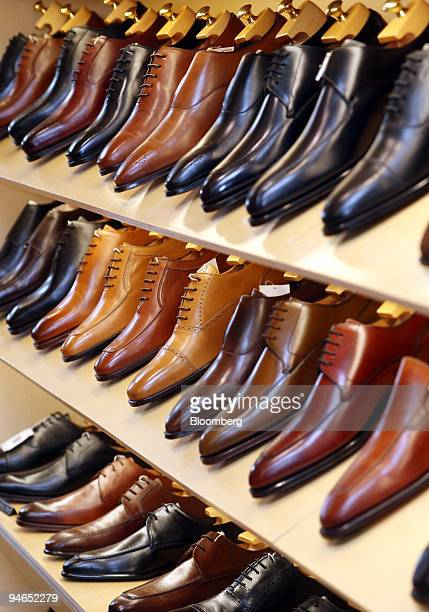 Mens leather shoes are displayed at Isetan department store in Tokyo, Japan on Tuesday, July 18, 2006. Japan's legions of monochrome-suited salarymen...