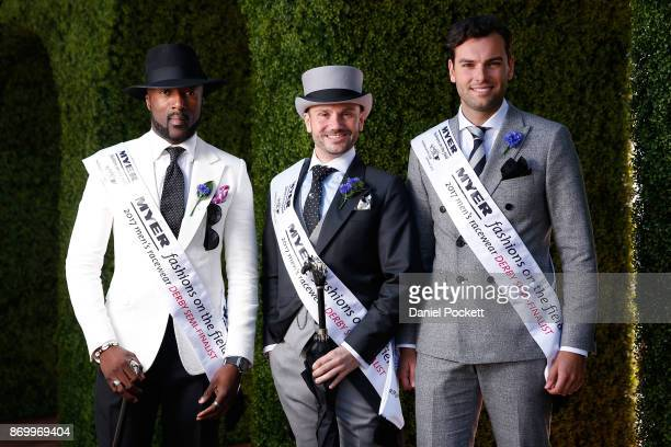 Men's Myer Fashions on the Field winners Gilles Belinga Neil Carpenter and Alexander Jordan pose at The Park on AAMI Victoria Derby Day at Flemington...