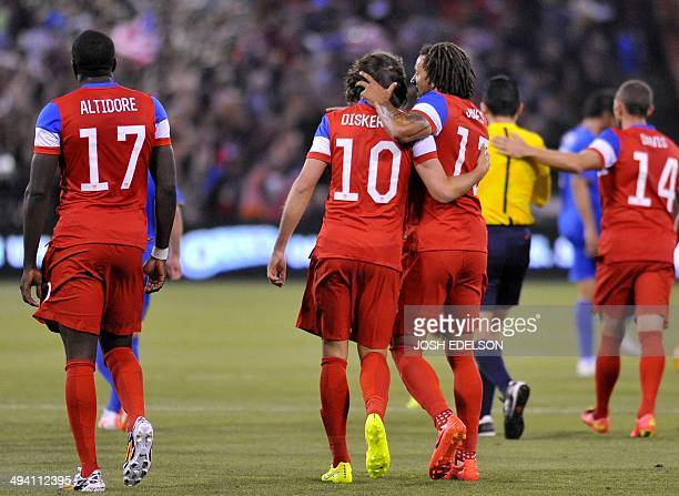 US men's national team player Jermaine Jones congratulates Mix Diskerud for scoring a goal during a World Cup preparation match against Azerbaijan at...