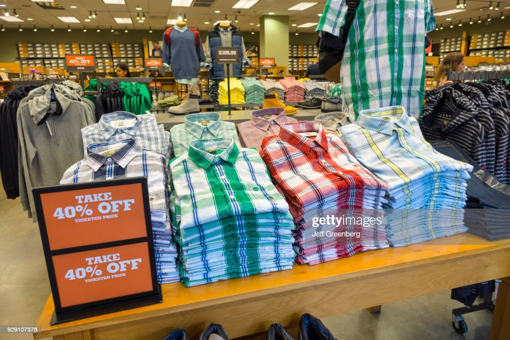 47d8652e4 Men s shirts for sale in Timberland at Orlando Premium Outlets International  Drive.   News Photo