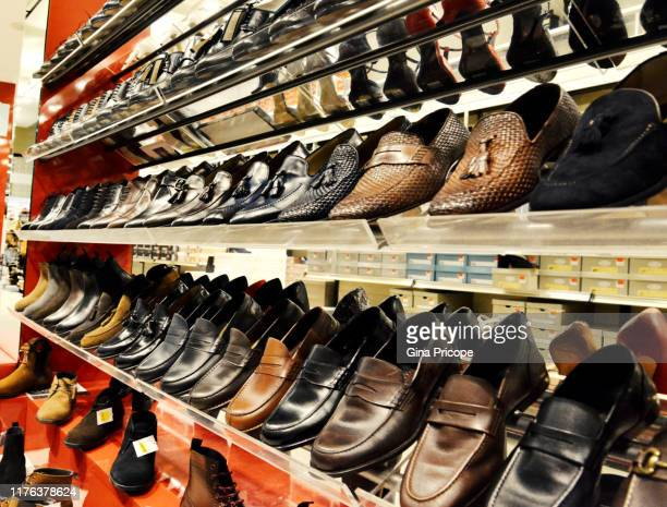 men's shoes on the shelves - loafers stock pictures, royalty-free photos & images