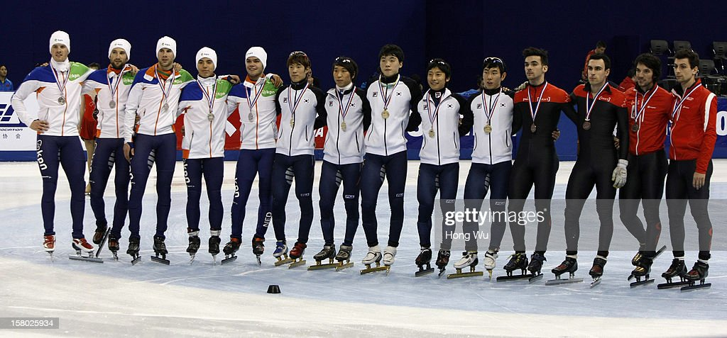 Men's short-track relay team members of Netherlands, Korea and Canada pose at the ceremony of the Men's 5000m Relay Final, during the day two of the ISU World Cup Short Track at the Oriental Sports Center on December 9, 2012 in Shanghai, China.