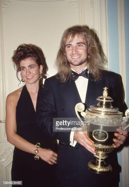 Men's Singles Champion Andre Agassi of the USA and his girlfriend Wendi Stewart pose with the trophy at the Wimbledon Champions' Dinner on July 5...