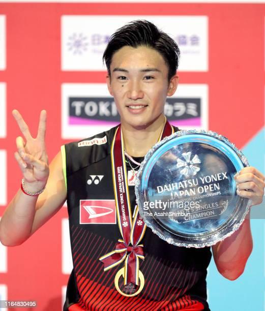 Men's Singles champion Kento Momota of Japan celebrates at the medal ceremony on day six of the Daihatsu Yonex Japan Open Badminton Championships...