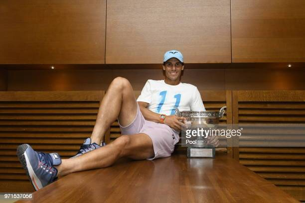 Mens singles Champion Rafael Nadal of Spain poses with the Musketeers' Cup in his dressing room following victroy in the mens singles final against...