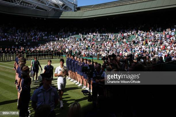 Mens Singles Final Novak Djokovic v Kevin Anderson A general view of Centre Court as Novak Djokovic walks down a tunnel of ball boys with the winners...