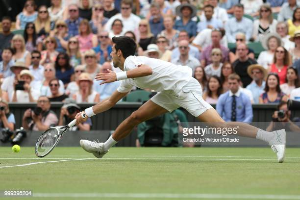 Mens Singles SemiFinal Rafael Nadal v Novak Djokovic Novak Djokovic stretches for the ball at All England Lawn Tennis and Croquet Club on July 14...
