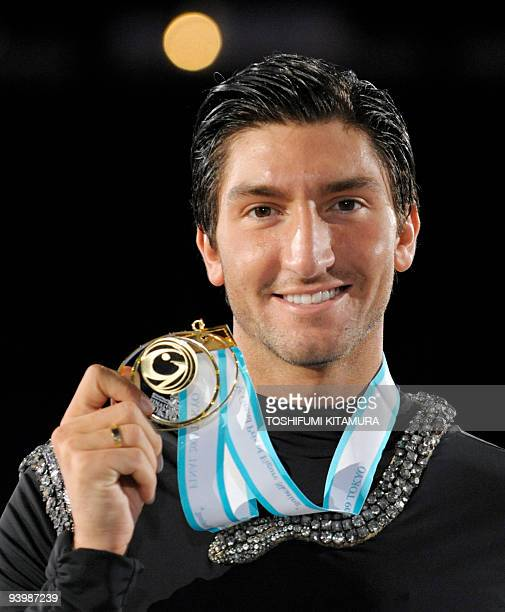 Men's singles winner Evan Lysacek of the US shows off his gold medal on the podium after the men's free skating singles competition of the figure...