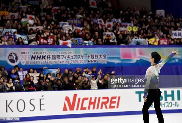Men's singles winner Japan's Yuzuru Hanyu greets spectators before the podium ceremony at the Grand Prix of Figure Skating 2016/2017 NHK Trophy in...