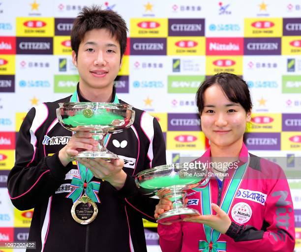 Men's Singles winner Jun Mizutani and Women's Singles winner Mima Ito pose for photographs after day seven of the All Japan Table Tennis...