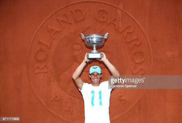 Men's singles winner Rafael Nadal of Spain poses with the Musketeers' Cup following his mens singles final victory over Dominic Thiem of Austria...