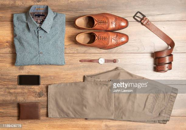 men's smart casual clothing - khaki trousers stock pictures, royalty-free photos & images