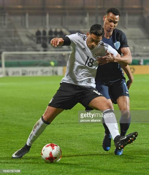 U21 men's soccer match Germany vs England in the BRITAArena in Wiesbaden Germany 24 March 2017 Germany's Nadiem Amiri and England's Jacob Murphy vie...
