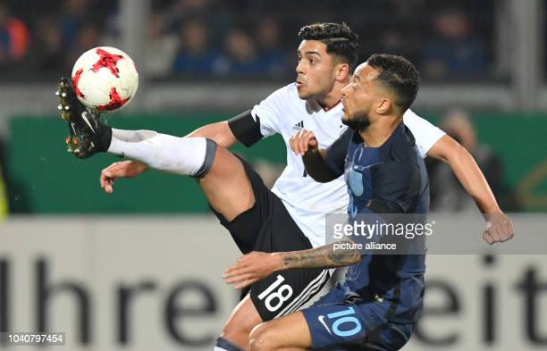 U21 men's soccer match Germany vs England in the BRITAArena in Wiesbaden Germany 24 March 2017 Germany's Nadiem Amiri view for the ball with...