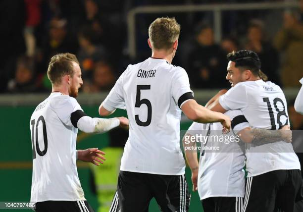 U21 men's soccer match Germany vs England in the BRITAArena in Wiesbaden Germany 24 March 2017 Germany's players MaximilianArnold Matthias Ginter...