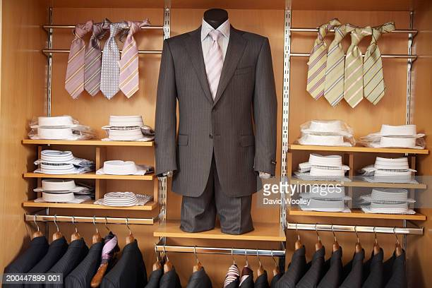 Mens' suits, shirts and ties in store display