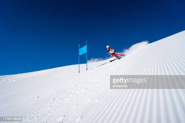 mens super g skiing with perfect weather conditions - ski racing stock pictures, royalty-free photos & images