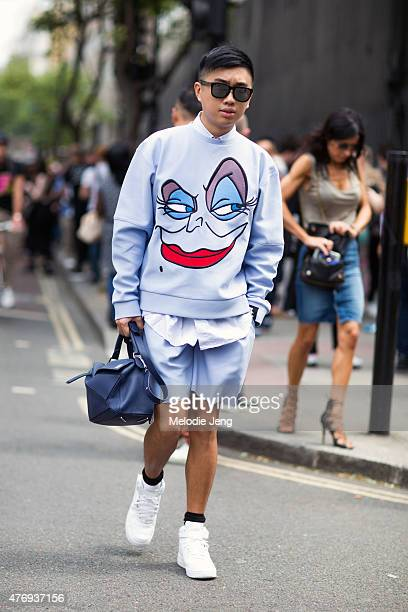 Mens Uno editor Declan Chan wears a Bobby Abley neoprene top and shorts JW Anderson shirt and Loewe bag during The London Collections Men SS16 at on...