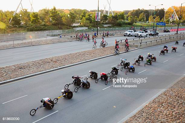 Mens wheelchair racers take off from Monroe street and head up Columbus Drive for the start of the Bank of America Chicago Marathon on October 9 2016...