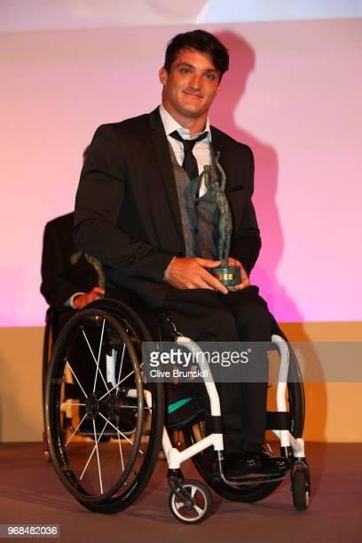Mens wheelchair World Champion Gustavo Fernandez collects his award during the ITF World Champions Dinner following day ten of the 2018 French Open...