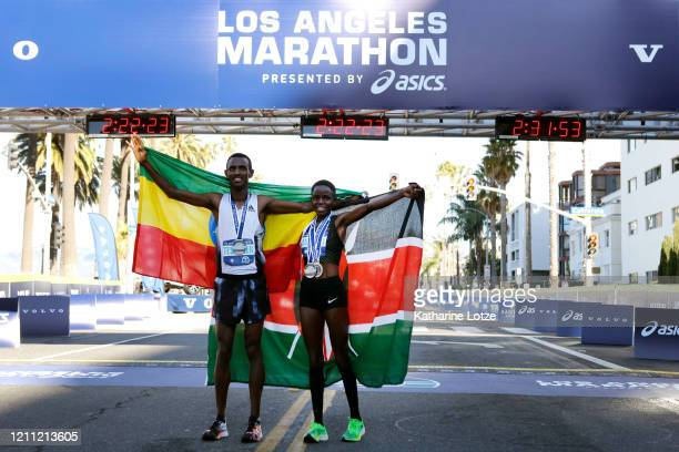 Men's winner Bayelign Teshager of Ethiopia and women's winner Margaret Muriuki of Kenya after the 2020 Los Angeles Marathon on March 08 2020 in Los...