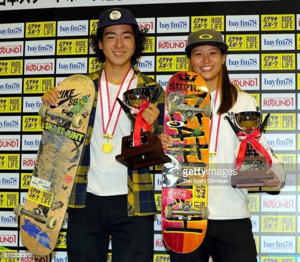 Men's winner Daisuke Ikeda and Women's winner Aori Nishimura pose for photographs after the medal ceremony during the first Japan Skateboarding...