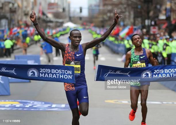 Men's winner Lawrence Cherono breaks the tape seconds before second place winner Lelisa Desisa in the 123rd Boston Marathon in Boston on April 15 2019