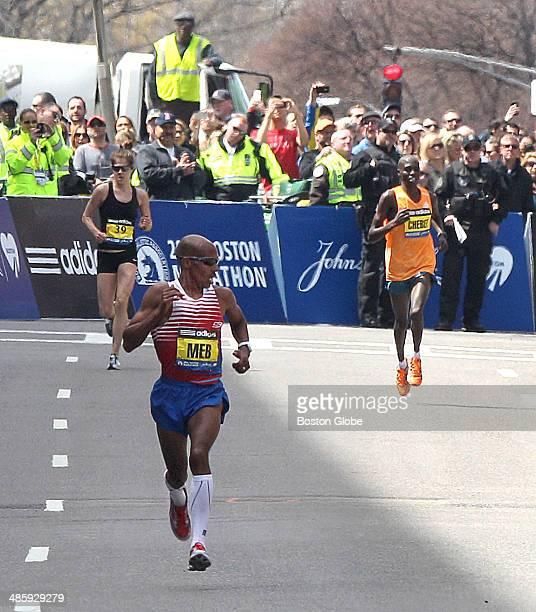 Men's winner Mebrahtom Keflezighi , of the United States, glances back at Wilson Chebet , of Kenya, on Boylston Street after turning off Hereford...