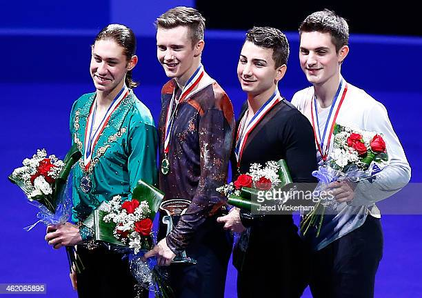 Men's winners including Jason Brown Jeremy Abbott Max Aaron and Joshua Farris stand on the podium during the medal ceremony during the 2014...