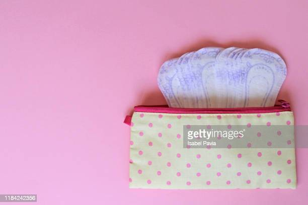 menstrual bag with sanitary napkins on pink background - styles stock pictures, royalty-free photos & images